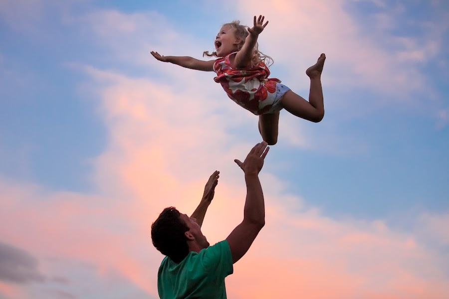 by Mike DeMicco - People Family ( playing, flying )