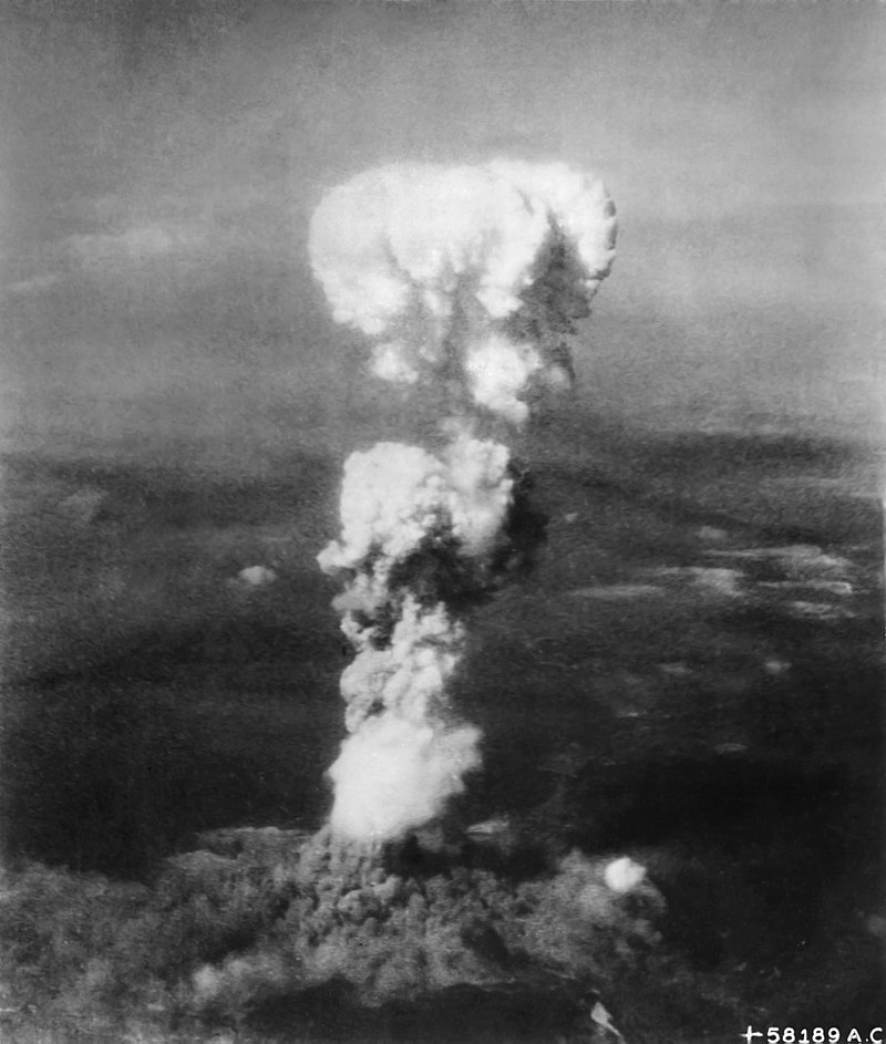 The mushroom cloud rising over Hiroshima during the nuclear attack.
