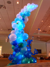 Photo: 7' tall wave balloon sculpture design by the Awesome Chris Horne CBA, a few extra details by us. Hanging topiary looked amazing with the cool LED ceiling! Under the Sea themed Grand Haven High School Prom 2011 at Trillium Banquet Hall, Spring Lake, Michigan. Beautiful place!