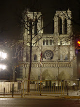 Photo: Notre Dame by night. Most of the illumination is by searchlights on buildings to the left.