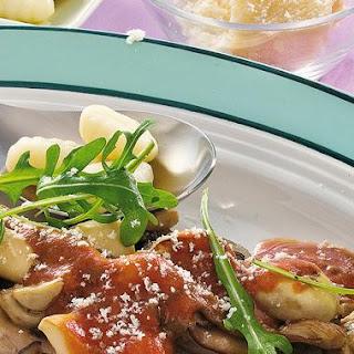 Gnocchi mit Prosciutto-Schwammerl Ragout mit Rucola