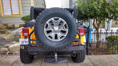 Photo: Rear Smittybilt Atlas bumper, closed tailgate.  Dog step lowered to lowest position; Daisy's still going to have to jump up a bit.