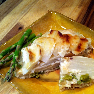 Scalloped Potatoes Layered With Asparagus and Sautéed Onion