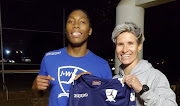 Olympic and world 800m champion Caster Semenya (L) pose with Banyana Banyana captain and owner of Janine van Wyk (R).