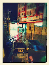 Photo: We were standing in the island of the street and figuring out how we're going to cross the chest-deep flood!