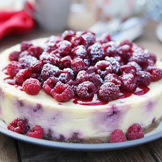 Baked White Chocolate and Raspberry Cheesecake.