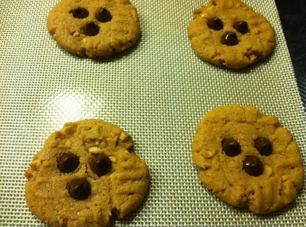 Remove to cookie rack and immediately place 3 chocolate chips ontop of cookies towards...