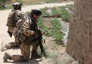 Photo: Czech Republic soldiers provide security in the village of Baraki Barak, Logar province, Afghanistan, during route clearance, in order to improve security in the area, July 06, 2011.