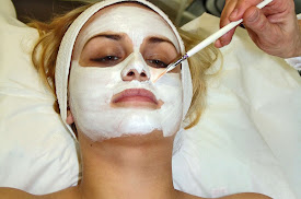 A lady having a face mask put on during cool peel treatment
