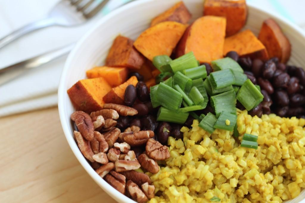 Top view of Black Bean and Sweet Potato Bowl with Turmeric Cauliflower Rice