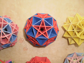 Photo: the 15 yellow squares, to the 15 pairs of edge midpoints of either icosahedron or dodecahedron. The one here shows both 6 blue + 10 red.