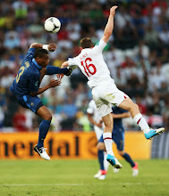 Photo: Patrice Evra of France and James Milner of England clash during the UEFA EURO 2012 group D match between France and England at Donbass Arena on June 11, 2012 in Donetsk, Ukraine.