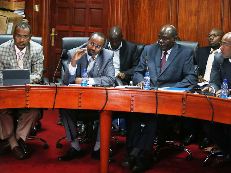IEBC commissioners (from L) Abdi Guliye, Boaya Molu, Chairman Wafula Chebukati and Acting CEO Marjan Hussein when they appeared before the PAC to respond to the audit queries on November 27, 2018.