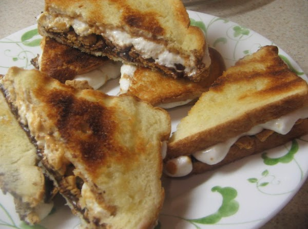 Place sandwiches in toaster oven and toast until lightly browned. Remove and cut in...