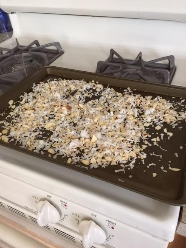 Bake coconut and almonds in shallow baking pans at 350*, stirring occasionally, 5-10 minutes...