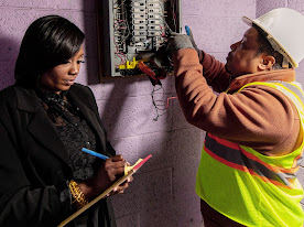 Man and woman checking voltage