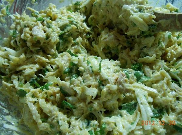 In mixing bowl combine cornmeal, flour, sugar, baking powder, salt, pepper, granulated garlic. Add...