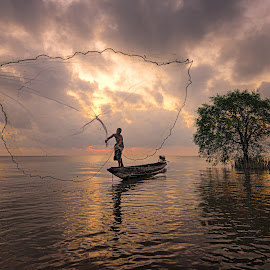 Luck by Vijay Tripathi - Landscapes Waterscapes ( waterscape, silhouette, serenity, sunrise, net, fisherman )
