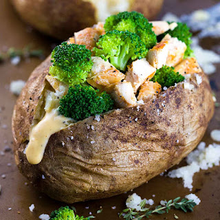 Chicken Broccoli Stuffed Baked Potato with Cheese Sauce.