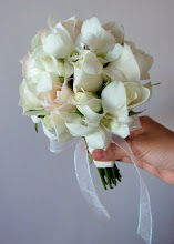 Photo: [B08] Hand tied bouquet with partial stem wrap featuring white and blush roses, and white dendrobium orchids