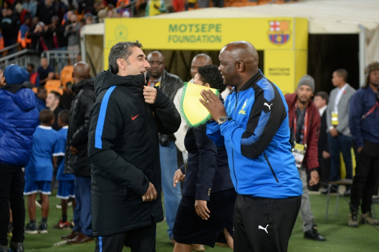 FC Barcelona head coach Ernesto Valverde and Mamelodi Sundowns head coach Pitso Mosimane during the International Club Friendly match at FNB Stadium on May 16, 2018 in Johannesburg, South Africa.