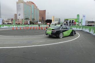 Photo: nVIDIA shows off dynamic reaction on their test track.  The crew keep moving the road sign to block the track and then removing it, and the car either goes left or follows the course each time.