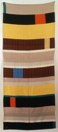 A colour photo of one of Anni Albers' textile fabrics in Bauhaus style, one of our featured women in design