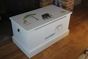 a toy box with various animals on it