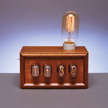 Photo: CLOCKWORKS Jeremy Medow '05 builds custom  furniture, lamps, and clocks that  combine fine craftsmanship with a vintage and modern industrial aesthetic. His Nixie Tube Sunrise alarm clock wakes you gently, using the gradual glow of an incandescent bulb. $345. Mention the BAM Gift Guide to receive 15% off. tungstencustoms.com