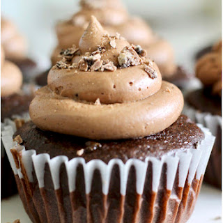 Chocolate Cupcakes with Milka Oreo Ganache Filling & Buttercream Frosting.