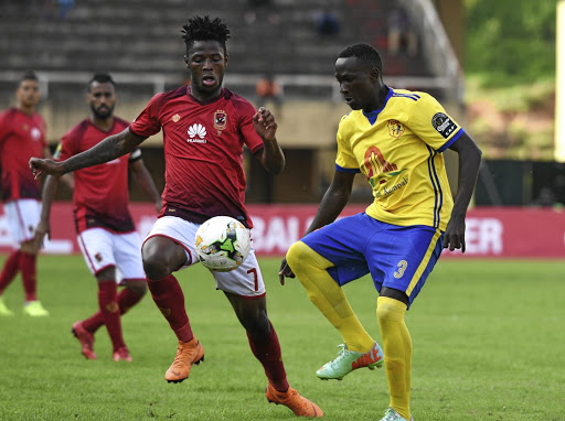 Phakamani Mahlambi of Al Ahly challenges Lawrence Bukenya of Kampala Capital City during his team's CAF Champions League game last month.