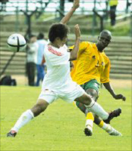 MY BALL: Innocent Mdledle of South Africa under - 23 national team fights for the ball with Liu Jianye of China in their Sasol Nations Cup match at Orlando Stadium in Soweto yesterday. Pic Antonio Muchave. 08/01/06. © Sowetan.