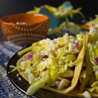 Spicy Fish Tacos with Mango Cabbage Slaw and Lime Crema.