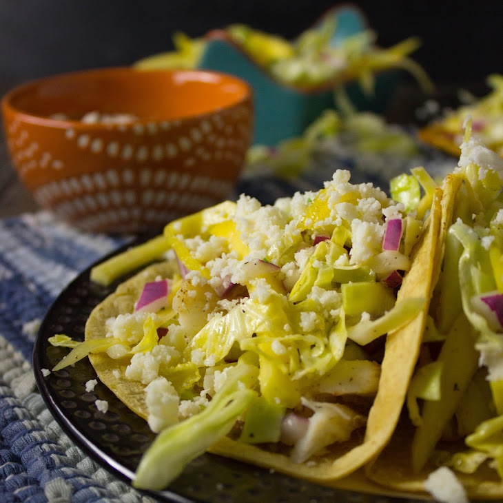 Spicy Fish Tacos with Mango Cabbage Slaw and Lime Crema Recipe ...