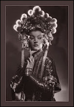 Photo: Similar visual complexity sometimes played directly into Hollywood's blatant Orientalism.  Here an anglo actress (Myrna Loy) plays a Eurasian character. This is a portrait of an actress in a role, rather than a portrait of the star 'herself.'