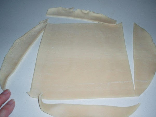 Unroll one pie crust and using a knife, square the edges or use a...