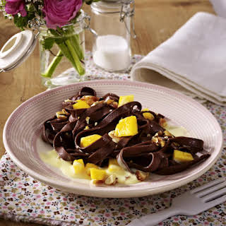 Chocolate Pasta with Mango, Almond Brittle, and Custard.