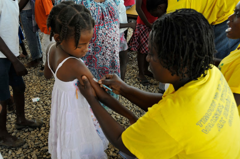 Photo: An elementary school in Port-of-Prince, Haiti, which was severely affected by the 2010 earthquake, opens its door to mothers and fathers who bring their sons and daughters to get measles-rubella and other vaccinations.  Photo credit: WHO/PAHO