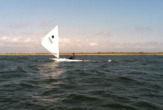 Photo: Bonnie surfing downwind.