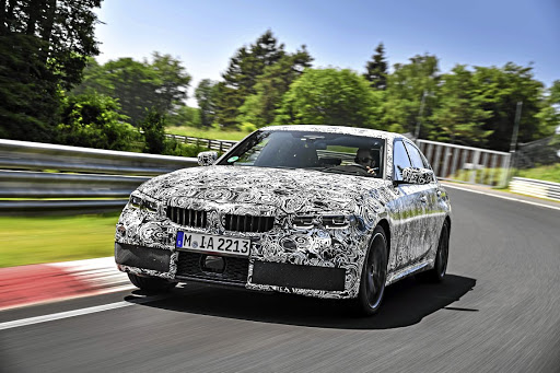 The camouflage still hides much of the revised design but the new 3 will be a little wider and lower. Picture: BMW