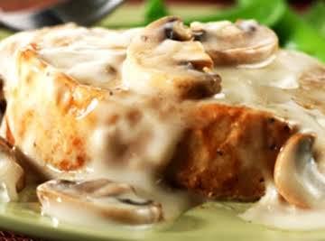 Pork chops in creamy mushroom sauce.
