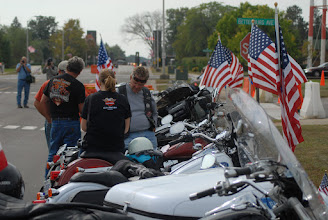 Photo: People wait for the Patriot Guards flag line near their motorcycles.