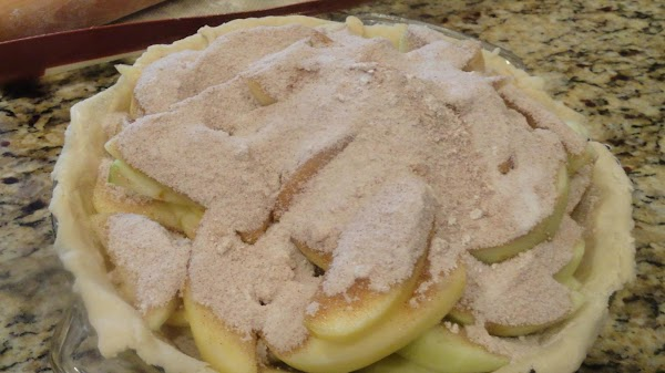 You have peeled your apples. Arrange apples in pie plate. Mix 1 cup sugar,...
