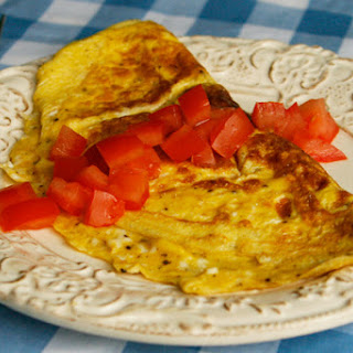 Three Cheese Almost Rolled Omelet with Tomatoes