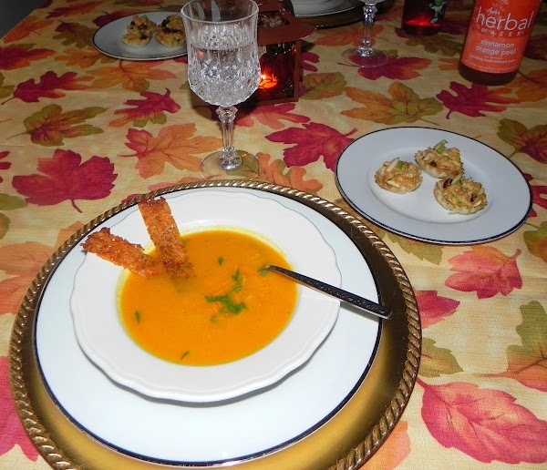 Ladle soup into bowls and garnish with fresh grated nutmeg, chopped thyme and orange...