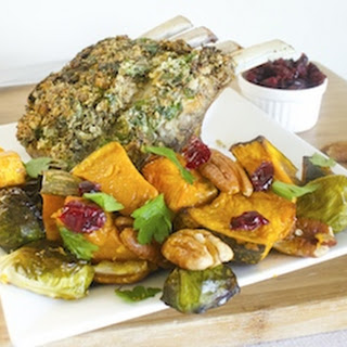 Roasted Herb and Garlic Crusted lamb with orange glazed vegetables