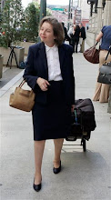 """Photo: Federal prosecutor Caroline Heck Miller leaves court after arguing before a federal appeals court during a hearing for the Cuban Five in Atlanta, Monday, Aug. 20, 2007. Defense attorneys representing five men convicted of spying for Fidel Castro's communist government asked federal appeals judges on Monday for a new trial, saying the so called """"Cuban Five"""" were victims of a flawed and heavily politicized trial. (AP Photo/John Bazemore)"""