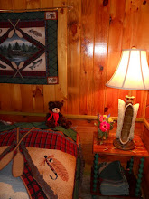 Photo: Adirondack touches in Woodsmoke's master bedroom, queen bed.