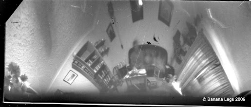Photo: Tilted 360 degree view.  Film canister camera, 15min, pre-flashed paper negative