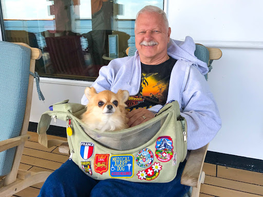 pete-bijou.jpg - Pete from Las Vegas with his service dog Bijou aboard ms Oosterdam.